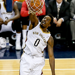 Dec 30, 2013; New Orleans, LA, USA; New Orleans Pelicans small forward Al-Farouq Aminu (0) dunks against the Portland Trail Blazers during the first half of a game at the New Orleans Arena. Mandatory Credit: Derick E. Hingle-USA TODAY Sports