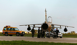 Police and security personnel gather around a Mirage F1 fighter jet after it landed at Malta International Airport outside Valletta February 21, 2011.  Two military jets reached Malta from Libya after flying in under radar cover, according to sources..Photo by Darrin Zammit Lupi