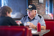 Roy Brooks enjoys his breakfast at McKee's 24 Hour Family Restaurant in Paris, Texas on December 15, 2014. (Cooper Neill for The Texas Tribune)