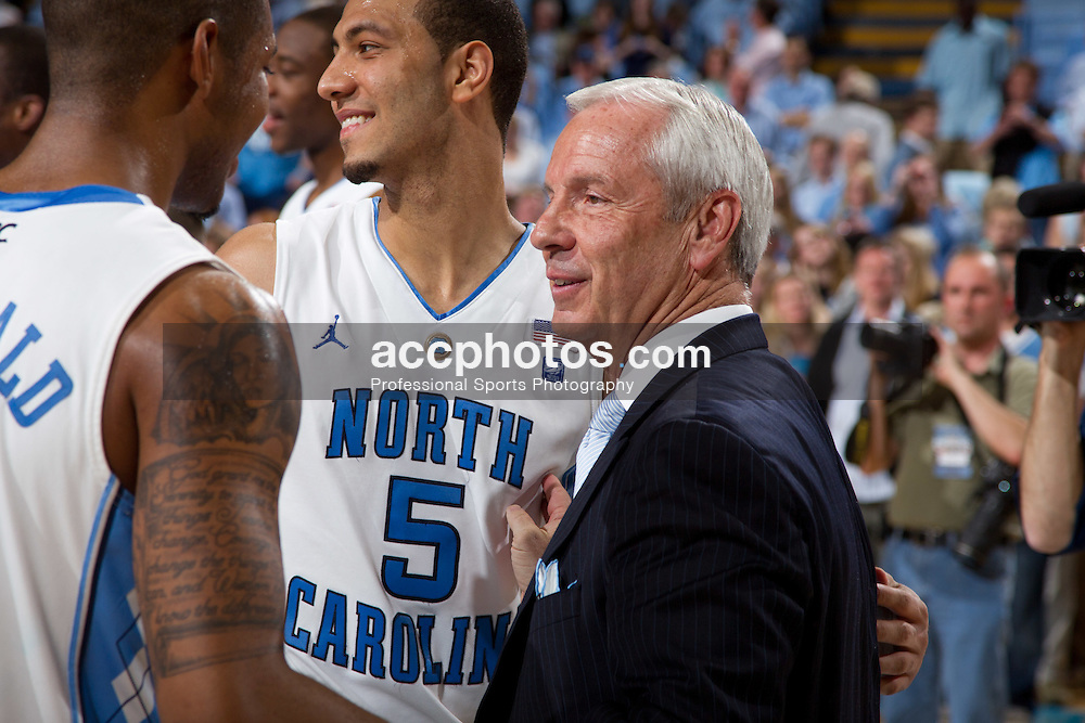 CHAPEL HILL, NC - MARCH 05: Head coach Roy Williams speaks with Leslie McDonald #2 and Kendall Marshall #5 of the North Carolina Tar Heels after playing the Duke Blue Devils on March 05, 2011 at the Dean E. Smith Center in Chapel Hill, North Carolina. North Carolina won 67-81. (Photo by Peyton Williams/UNC/Getty Images) *** Local Caption *** Roy Williams;Kendall Marshall;Leslie McDonald