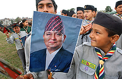 Children hold posters of King Gyanendra and Queen Komal as thousands of people arrive to celebrate Democracy Day and to greet  the Queen who was marking her 55th birthday in Kathmandu, Nepal February 18, 2005.  Nepal marked its annual Democracy Day under emergency rule with severe press censorship, telephones cut and streets flooded with security forces.  King Gyanendra got rid of the government and declared emergency rule on February 1 saying that the country  is under threat from Maoist rebels and political instability.  The Maoist insurgency has claimed over 11,000 lives since 1996. (Ami Vitale)