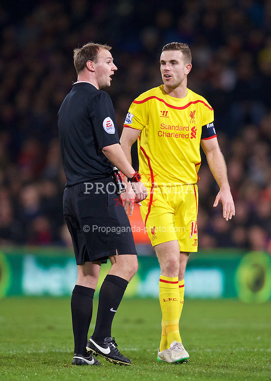 LONDON, ENGLAND - Saturday, February 14, 2015: Liverpool's captain Jordan Henderson talk to referee Robert Madley against Crystal Palace during the FA Cup 5th Round match at Selhurst Park. (Pic by David Rawcliffe/Propaganda)