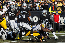 OAKLAND, CA - DECEMBER 09: Running back Stevan Ridley #22 of the Pittsburgh Steelers scores a touchdown  against the Oakland Raiders during the second quarter at the Oakland Coliseum on December 9, 2018 in Oakland, California. The Oakland Raiders defeated the Pittsburgh Steelers 24-21. (Photo by Jason O. Watson/Getty Images) *** Local Caption *** Stevan Ridley