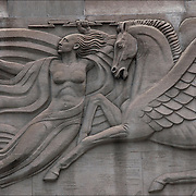Three allegorical Art Deco bas-relief sculptures located north of the entrance to the Radio City Music Hall at 1270 6th Avenue in Manhattan by Oscar Bach.<br />