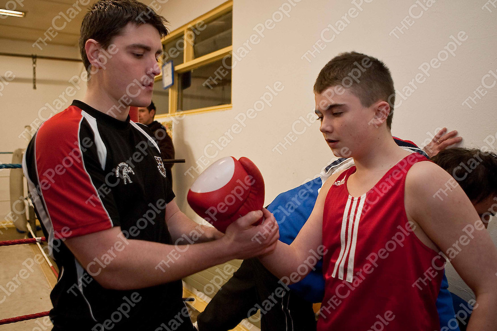Danny Fitzpatrick preparing Colm Fitzgerald for the Clare Boxing Championships on Wednesday night last. Photograph by Eamon Ward