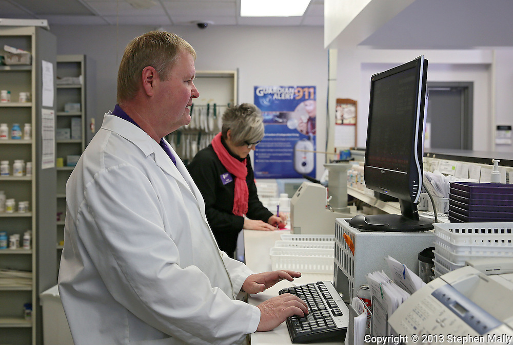 Pharmacist Gary Grabe works at a computer at Medicap Pharmacy in Cedar Rapids on Tuesday, March 19, 2013.