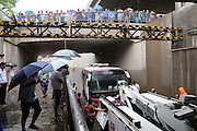 XI\'AN, CHINA - AUGUST 12: (CHINA OUT) <br /> <br /> Bus Gets Submerged In Water At Tunnel <br /> <br /> A recovery vehicle stops near a bus submerged in water on August 12, 2014 in Xi\'an, Shaanxi province of China. Torrential rains hit Xi\'an, which caused more and more standing waters on Xi\'an, Shaanxi province of China<br /> ©Exclusivepix