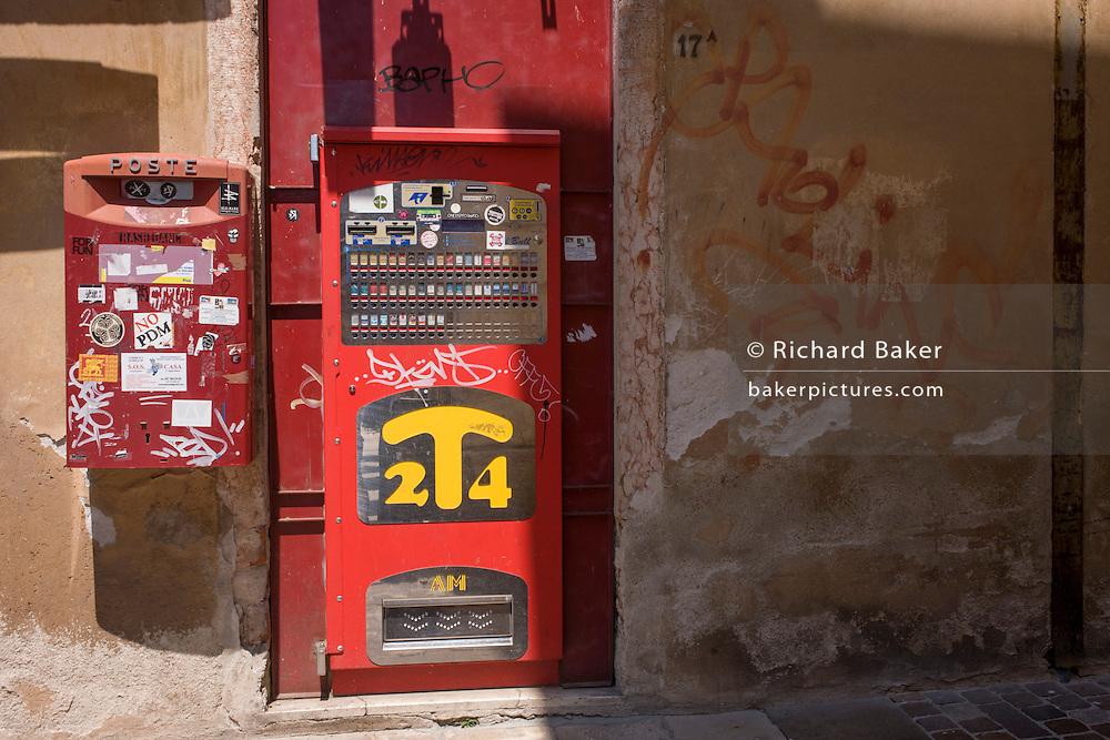 Detail of an Italian cigarette dispenser in a Bassano street.