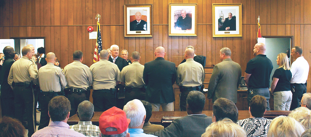 (Amanda Clark / Buy at photos.chickasawjournal.com)<br /> Chickasaw County deputies, investigators, constables, jailers, coroner and sheriff formally took the oath of office from Judge John Gregory at the Chickasaw County Courthouse last week. The event was witnessed by family and friends who packed the courtroom gallery.