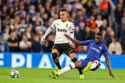 Chelsea defender Fikayo Tomori (29) tackles Valencia CF forward Rodrigo (19) during the Champions League match between Chelsea and Valencia CF at Stamford Bridge, London, England on 17 September 2019.