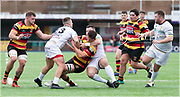 Yet another high tackle on Carmarthen Quins' second row Josh Helps missed by the referee.<br /> <br /> Photographer: Dan Minto<br /> <br /> Indigo Welsh Premiership Rugby - Round 11- Merthyr RFC v Carmarthen Quins RFC - Saturday 21st December 2019 - Y Wern, Merthyr, South Wales, UK.<br /> <br /> World Copyright © Dan Minto Photography<br /> <br /> mail@danmintophotography.com <br /> www.danmintophotography.com