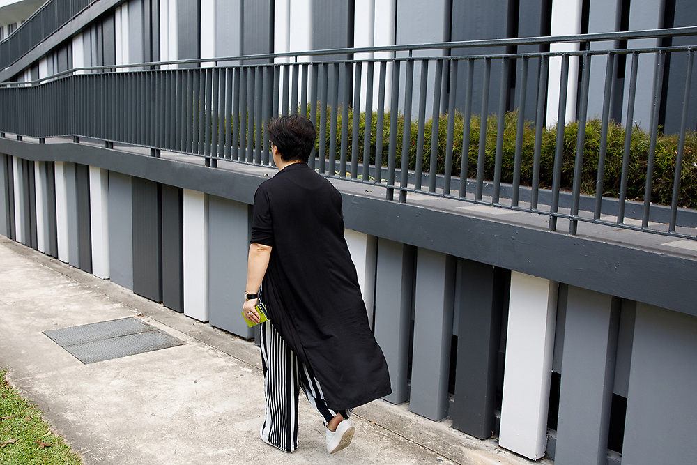 A woman passes by the Pinnacle building at Duxton Hill, Singapore.