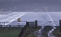 © Licensed to London News Pictures. 20/12/2018. London, UK. An emergency vehicle checks the runway at Gatwick airport at first light. Flights have been cancelled and thousands of passengers have been delayed after the airport closed due to two drones being spotted nearby. Photo credit: Peter Macdiarmid/LNP