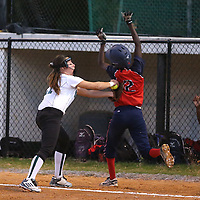 Lauren Wood   Buy at photos.djournal.com<br /> Mooreville's Kelsey Minga tags out Nettleton's Mycah Hall as she runs to first base during Tuesday night's 3A softball semifinal game. Nettleton defeated Moorville 28-13.