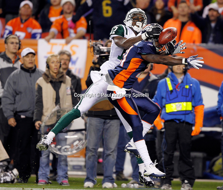 New York Jets wide receiver Plaxico Burress (17) leaps while trying to catch a deep pass while covered by Denver Broncos cornerback Andre' Goodman (21) during the NFL week 11 football game against the Denver Broncos on Thursday, November 17, 2011 in Denver, Colorado. The Broncos won the game 17-13. ©Paul Anthony Spinelli