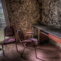 Old very moldy hotel. <br /> Hotel Schimmelig interior with chairs and desk