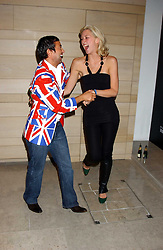 JULIEN MACDONALD and actress MARGO STILLEY at a cocktail party hosted by MAC cosmetics to kick off London Fashion Week at The Hospital, 22 Endell Street London on 18th September 2005.At the event, top model Linda Evangelista presented Ken Livingston the Lord Mayor of London with a cheque for £100,000 in aid of the Loomba Trust that aims to privide education to orphaned children through a natural disaster or through HIV/AIDS.<br /><br />NON EXCLUSIVE - WORLD RIGHTS