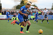 AFC Wimbledon striker Lyle Taylor (33) battles for possession during the EFL Sky Bet League 1 match between AFC Wimbledon and Peterborough United at the Cherry Red Records Stadium, Kingston, England on 12 November 2017. Photo by Matthew Redman.