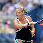 2017 U.S. Open Tennis Tournament - DAY THREE. Timea Babosof Hungary in action during her match against Maria Sharapova of Russia during the Women's Singles round two match at the US Open Tennis Tournament at the USTA Billie Jean King National Tennis Center on August 30, 2017 in Flushing, Queens, New York City.  (Photo by Tim Clayton/Corbis via Getty Images)