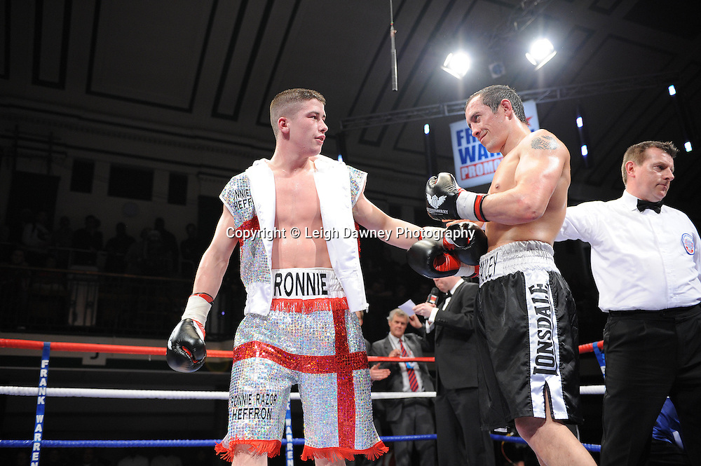 Welterweight Ronnie Heffron (George Cross shorts) acknowledges a good fight after defeating Kevin McCauley at York Hall, Bethnal Green, London on the 19th February 2011. Frank Warren Promotions. Photo credit © Leigh Dawney.