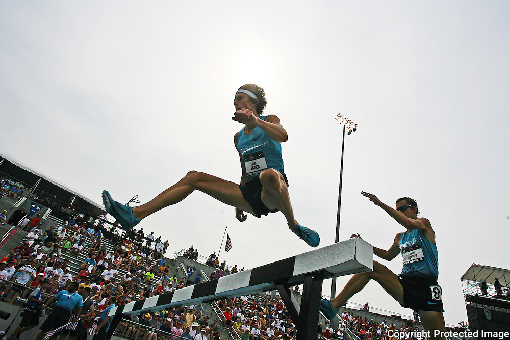 JAGER - 13USA, Des Moines, Ia.  - Steeplechaser Evan Jager glides over a hurdle en route to his win.  Photo by David Peterson