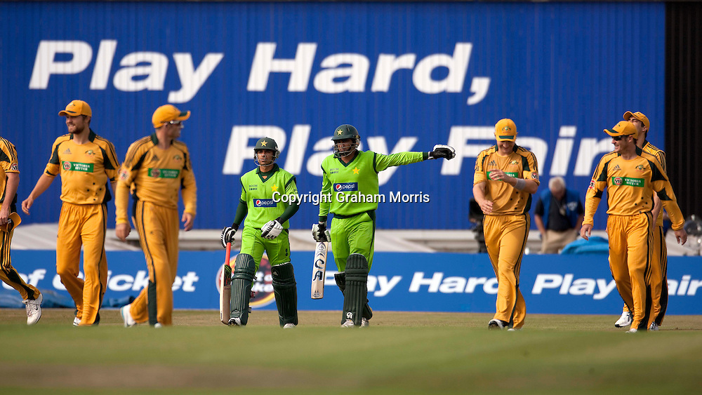 Salman Butt and Shahzaib Hasan (right) walk out to bat during the first International T20 match between Australia and Pakistan at Edgbaston, Birmingham.  Photo: Graham Morris (Tel: +44(0)20 8969 4192 Email: sales@cricketpix.com) 05/07/10