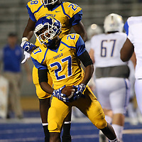 Tupelo's Tabias Morris celebrates with teammate Jake Morris after intercepting the ball during Friday night's game against Oxford.