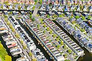 Nederland, Flevoland, Almere, 07-05-2015;  Almere-Buiten, Eilandenbuurt eengezinswoningen en stadsvilla's omgeven door waterpartijen met drijvende woningen.<br /> Eilandenbuurt (Island Area), town houses and urban villas surrounded by water.<br /> luchtfoto (toeslag op standard tarieven);<br /> aerial photo (additional fee required);<br /> copyright foto/photo Siebe Swart
