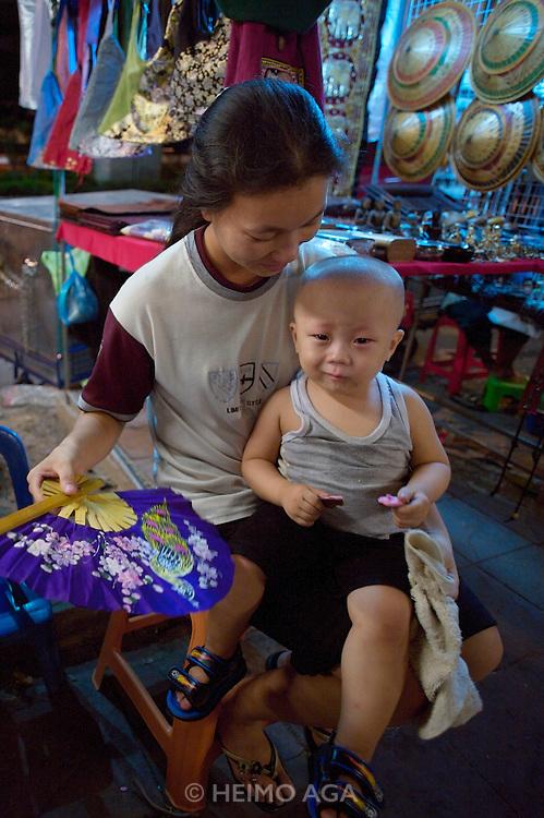 Silom Road night market. Cool kid.