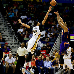 Nov 4, 2016; New Orleans, LA, USA; Phoenix Suns forward TJ Warren (12) shoots over New Orleans Pelicans forward Anthony Davis (23) during the first quarter of a game at the Smoothie King Center. Mandatory Credit: Derick E. Hingle-USA TODAY Sports