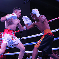 Agustin Gauto of Argentina (L) punches Jose Antonio Jiminez of Columbia during their championship boxing match for the WBO Latin American light flyweight title at the Hotel El Panama Convention Center on Wednesday, October 31, 2018 in Panama City, Panama. (Alex Menendez via AP)