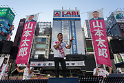 Former actor, Taro Yamamoto, leader of the anti-establishment political party Reiwa Shinsengumi, ,electioneering in Shimbashi for the 2020 Tokyo Gubernatorial elections. Tokyo, Japan. Thursday July 2nd 2020. The  elections for Tokyo Governor take place on Sunday July 5th. The incumbent, Yuriko Koike (not pictured) is expected to easily win reelection for her second term as leader of Japan's capital city. Photo by Damon Coulter/AFLO