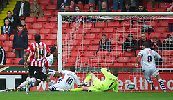 SHEFFIELD, ENGLAND - Saturday, March 17, 2012: Tranmere Rovers' goalkeeper Owain Fon Williams is beaten by Welsh compatriot  Sheffield United's Ched Evans for the opening goal during the Football League One match at Bramall Lane. (Pic by David Rawcliffe/Propaganda)