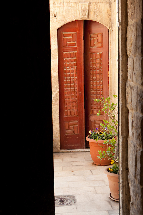A view through an open door into a courtyard and another doorway, off a street in the Old City, Aleppo, Syria