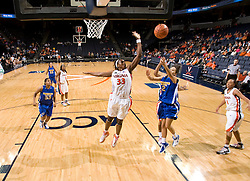 Virginia center Aisha Mohammed (33) goes up to block a shot by Morehead St. guard Chynna Bozeman (2).  The Virginia Cavaliers women's basketball team defeated the Morehead State Eagles 88-43 at the John Paul Jones Arena in Charlottesville, VA on February 4, 2008.