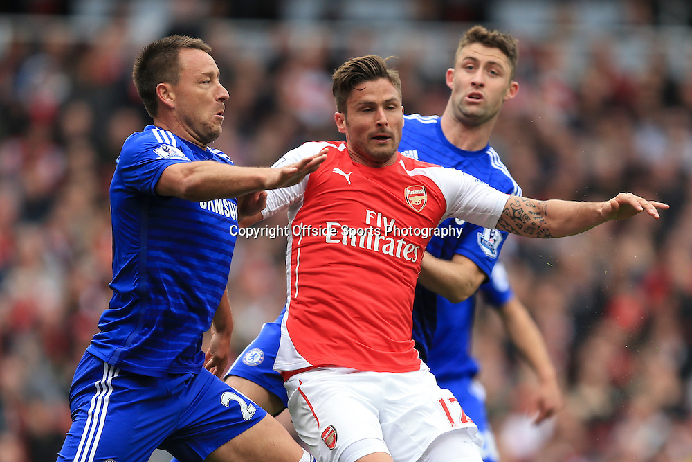 26 April 2015 - Barclays Premier League - Arsenal v Chelsea - Olivier Giroud of Arsenal tangles with John Terry and Gary Cahill of Chelsea - Photo: Marc Atkins / Offside.