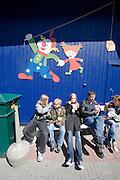 Linnanma?ki (Borgbacken) Luna Park. Visitors enjoy snacks in the sun.