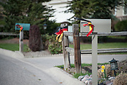 On May 2, 2014 memorial ribbons in honor of Diren Dede, the 17-year-old German exchange student who was shot and killed by a neighbor, decorate the streets in the Grant Creek, Missoula, Montana neighborhood where he lived with his host family.