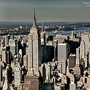 Midtown Manhattan in the foreground with the Hudson River and New Jersey in the distance in this aerial view.