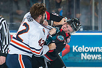 KELOWNA, CANADA - SEPTEMBER 22: Kobe Mohr #42 of the Kamloops Blazers drops the gloves with Mark Liwiski #9 of the Kelowna Rockets in first period on September 22, 2018 at Prospera Place in Kelowna, British Columbia, Canada.  (Photo by Marissa Baecker/Shoot the Breeze)  *** Local Caption ***