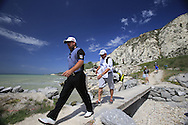 Graeme McDowell (NIR) and caddy Ken Comboy cross the footbridge to the ocean bound 9th tee box during Saturday Morning's Last 16 Group of the 2013 Volvo World Matchplay Championship held  at the Thracian Cliffs Golf & Beach Resort, Kavarna, Bulgaria, 18th May 2013..Picture: Eoin Clarke www.golffile.ie.