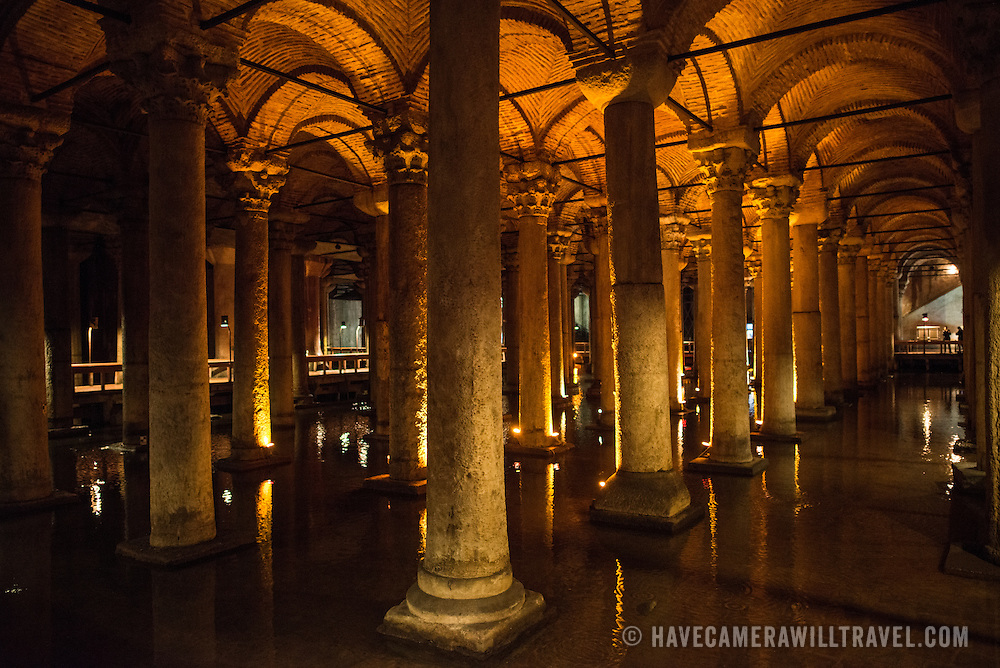 The Basilican Cistern is located in the historical peninsular of Istanbul in the Sultanahment district. It was built in the 6th century during the reign of Justinianus. It's 140 metres long and 70 metres wide and covers a total area of 9.9 square miles. There are 336 marble columns, each 9 metres high, arranged in 12 rows of 28 columns. Most are in the ionic and Corinthian styles, although a few are Doric style. The water comes from the Belgrade Woods, 19 kilometres north of the city, transported by aquaducts. Among Roman age art sculptures are two Medusa's heads carved into columns.