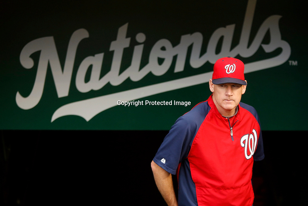 Manager Matt Williams of the Washington Nationals walks int he dugout before his team's 11-0 win over the Philadelphia Phillies at Nationals Park.