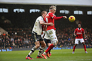 Charlton Athletic striker, Simon Makienok (9) holding up the ball from Fulham defender, Dan Burn (33) during the Sky Bet Championship match between Fulham and Charlton Athletic at Craven Cottage, London, England on 20 February 2016. Photo by Matthew Redman.