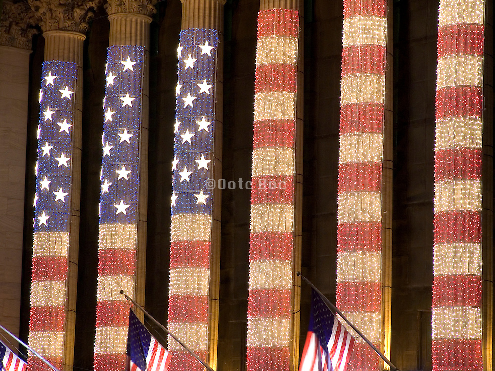 New York Stock Exchange decorated with a big American flag made out of string lights