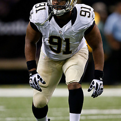 Aug 16, 2013; New Orleans, LA, USA; New Orleans Saints linebacker Will Smith (91) against the Oakland Raiders during the second quarter of a preseason game at the Mercedes-Benz Superdome. Mandatory Credit: Derick E. Hingle-USA TODAY Sports