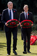 British Chamber of Commerece President, David Bickle (left) laying a wreath of poppies during the Remembrance Sunday ceremony at the Hodogaya, Commonwealth War Graves Cemetery in Hodogaya, Yokohama, Kanagawa, Japan. Sunday November 12th 2017. The Hodagaya Cemetery holds the remains of more than 1500 servicemen and women, from the Commonwealth but also from Holland and the United States, who died as prisoners of war or during the Allied occupation of Japan. Each year officials from the British and Commonwealth embassies, the British Legion and the British Chamber of Commerce honour the dead at a ceremony in this beautiful cemetery.