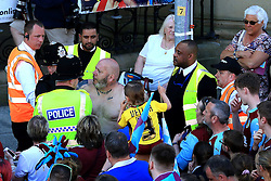 A fan is escorted away by police - Mandatory by-line: Matt McNulty/JMP - 09/05/2016 - FOOTBALL - Burnley Town Hall - Burnley, England - Burnley FC Championship Trophy Presentation
