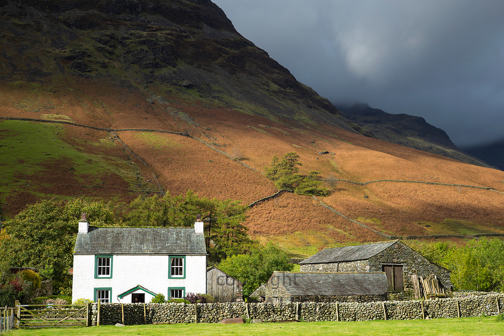 Traditional farm at Wasdale beneath Yewbarrow Fell mountain in the Lake District, Cumbria, UK