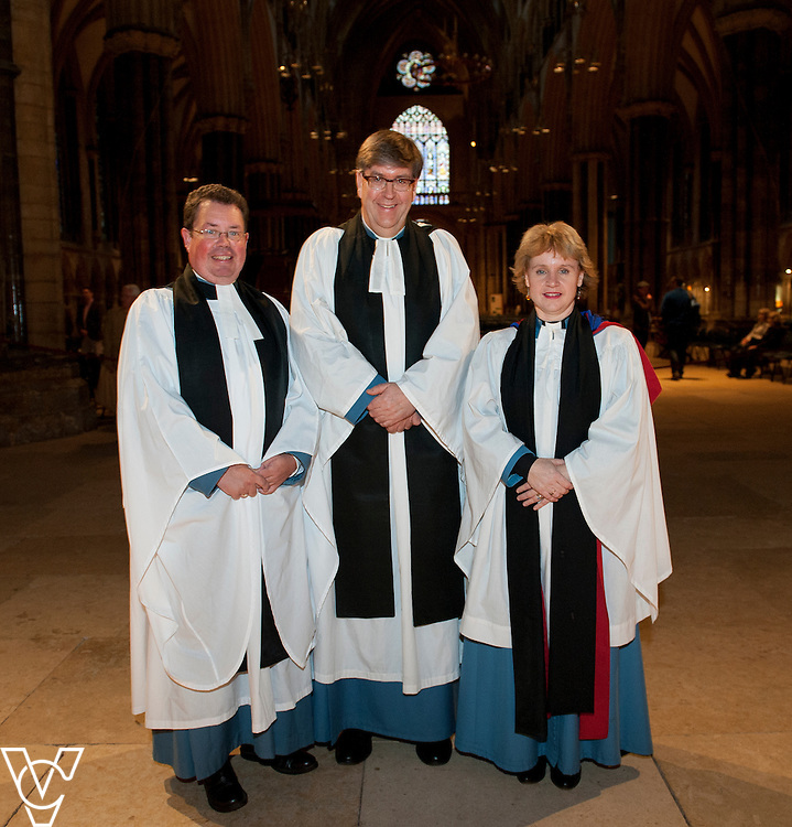 Pictured, from left, Archdeacon of Stow and Lindsey Rev Mark Steadman, The Archdeacon of Lincoln The Venerable Tim Barker and The Archdeacon of Boston The Venerable Dr Justine Allain Chapman<br /> <br /> Rev Mark Steadman is installed as Archdeacon of Stow and Lindsey during a service of Evensong at Lincoln Cathedral.<br /> <br /> Picture: Chris Vaughan/Chris Vaughan Photography<br /> Date: October 10, 2015